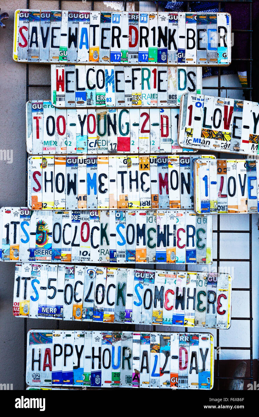 Comedy signs made from pieces of car number plates, on sale, Puerto Vallarta, Mexico - Stock Image