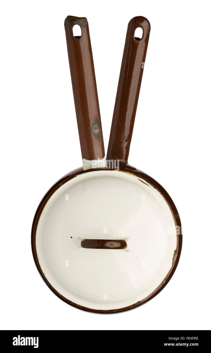 Old white and brown enameled bain marie cooking pot. Double boiler for gently melting chocolate. - Stock Image