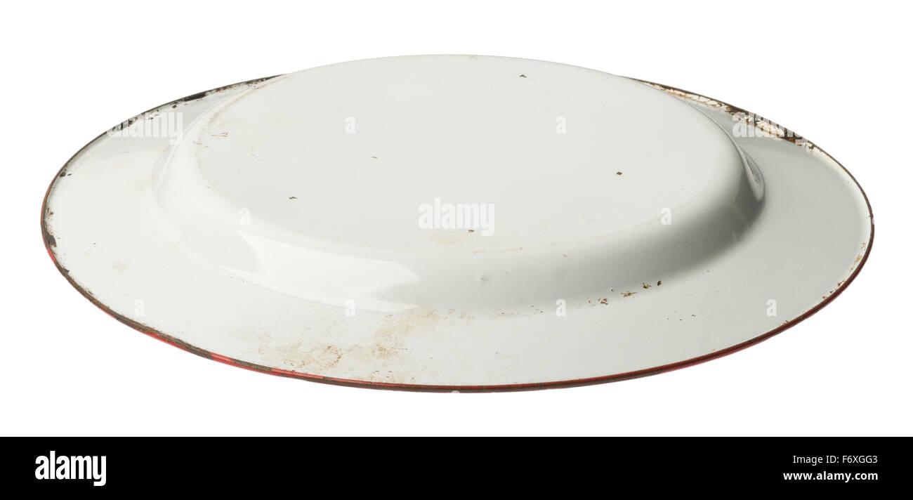 Enamel plate. Enamelled metal plate with red painted rim. Upside down - Stock Image