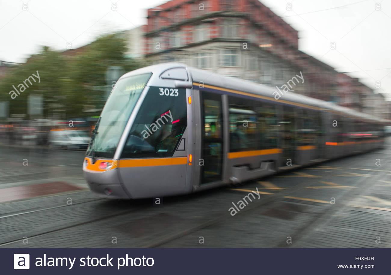 Dublin Ireland Luas Tram system. Tram in motion. - Stock Image