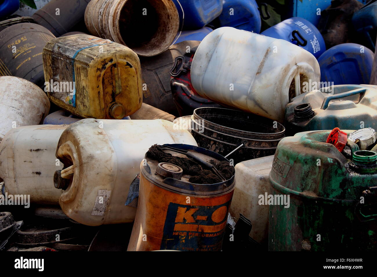 After a painting work dumping some paint buckets. - Stock Image
