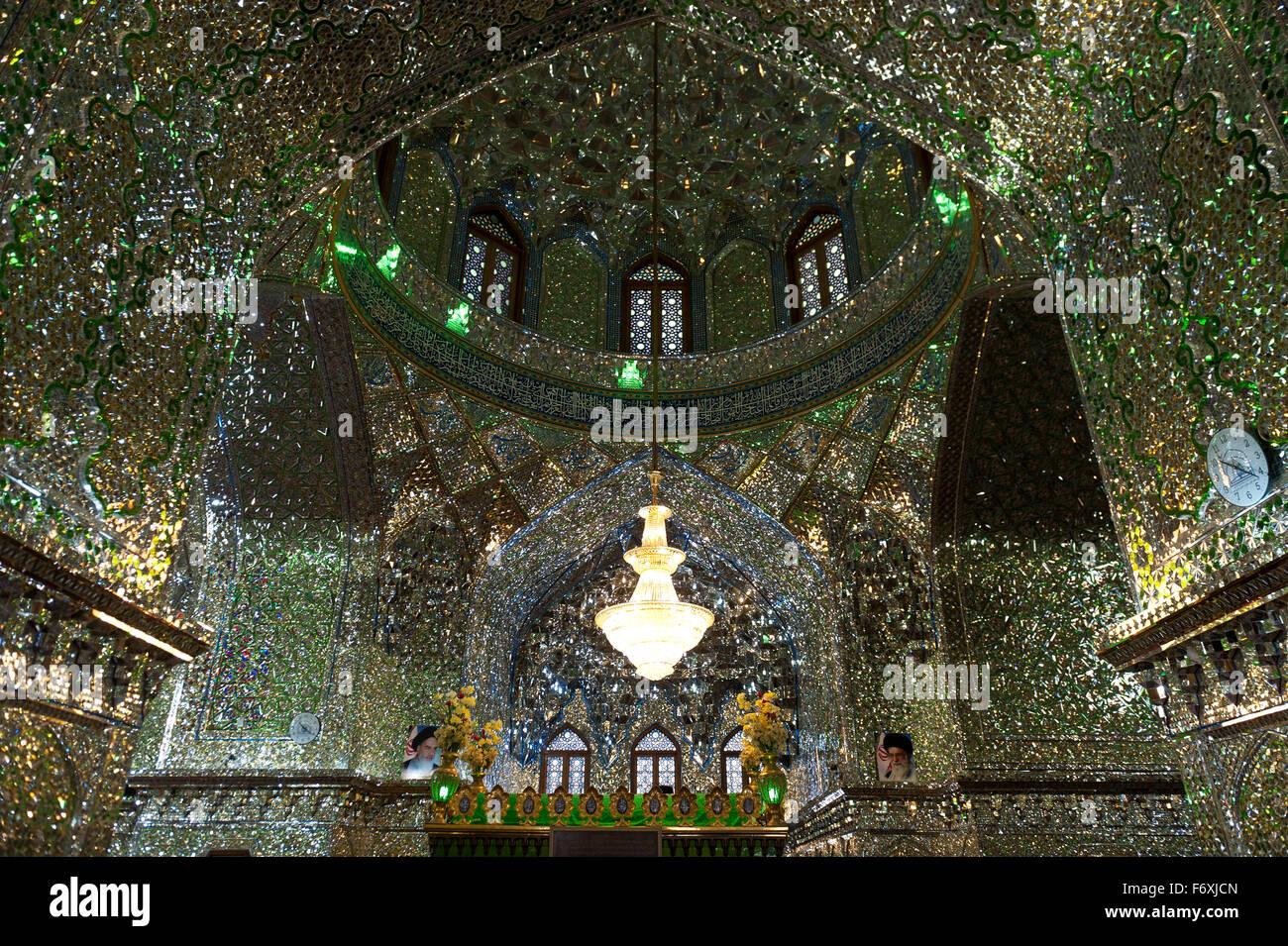 Glistening interior with mirror mosaics, mausoleum, tombs, Shāh Chérāgh, Shiraz, Iran - Stock Image