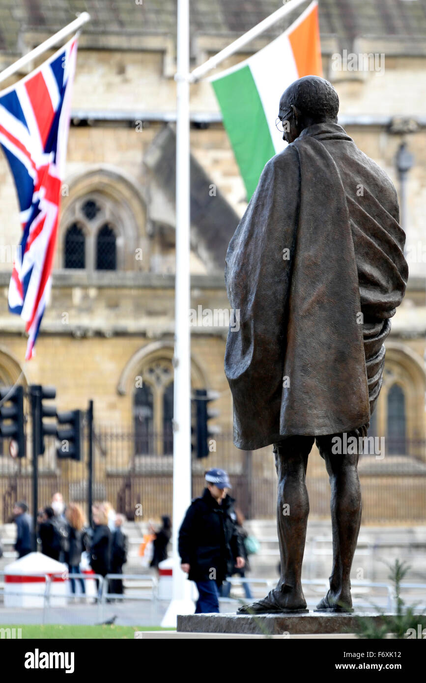 London, England, UK. Statue of Mahatma Gandhi, Parliament Square. (2015: Philip Jackson) with Indian and British - Stock Image