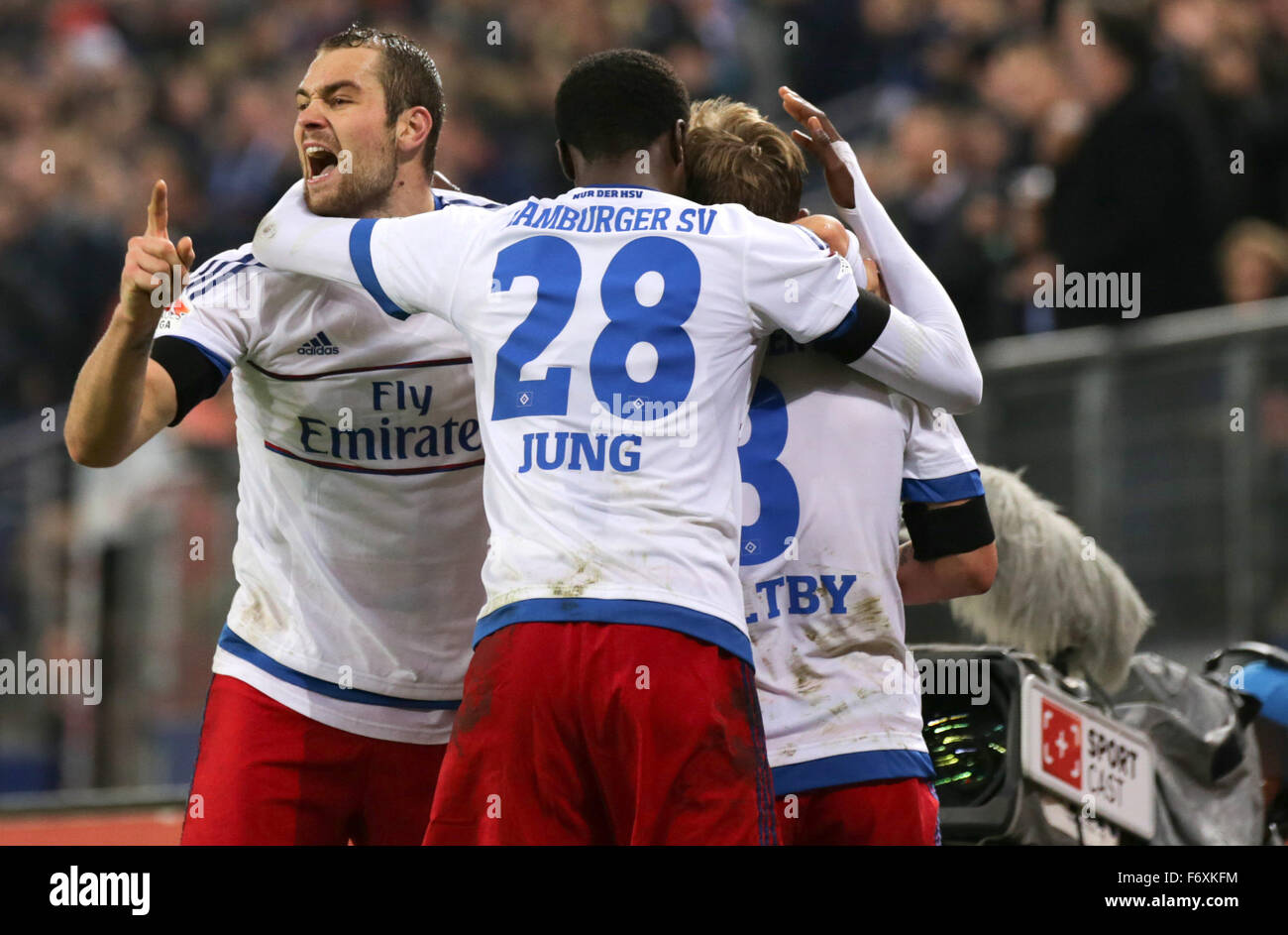 Hamburg, Germany. 20th Nov, 2015. Hamburg's Pierre-Michel Lasogga (L-R), Gideon Jung and Lewis Holtby (unseen) - Stock Image