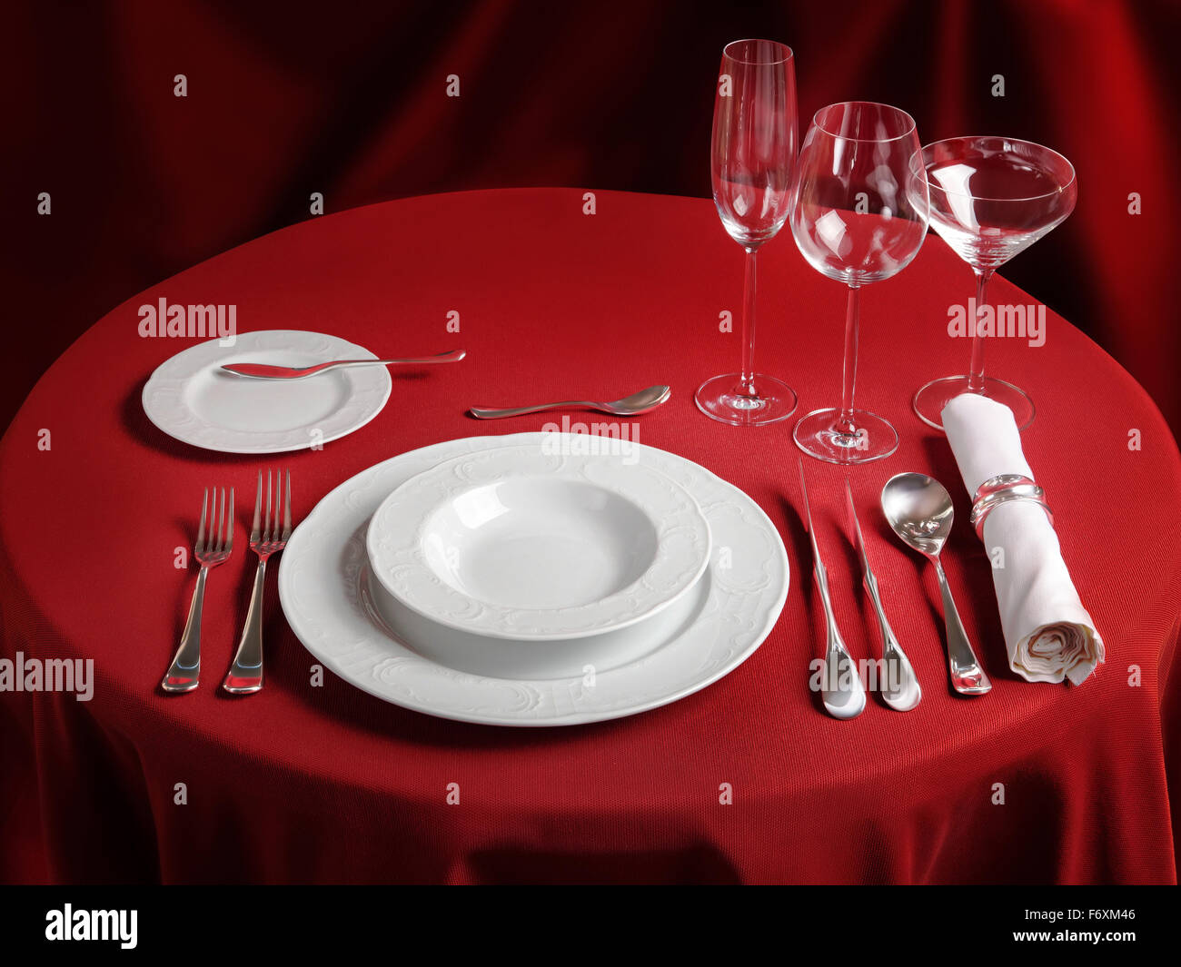 Red table with dinner set. Professional banquet table setting Stock ...