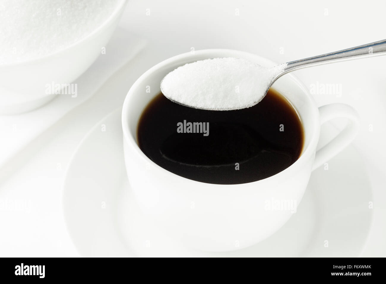 Cup of coffee with spoon full of sugar - Stock Image