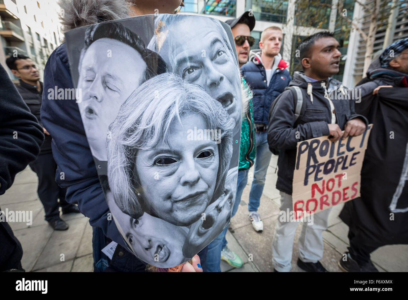 "London, UK. 21st November, 2015. ""No Borders No Bigots"" LGBTI support for migrants protest and rally outside Home - Stock Image"