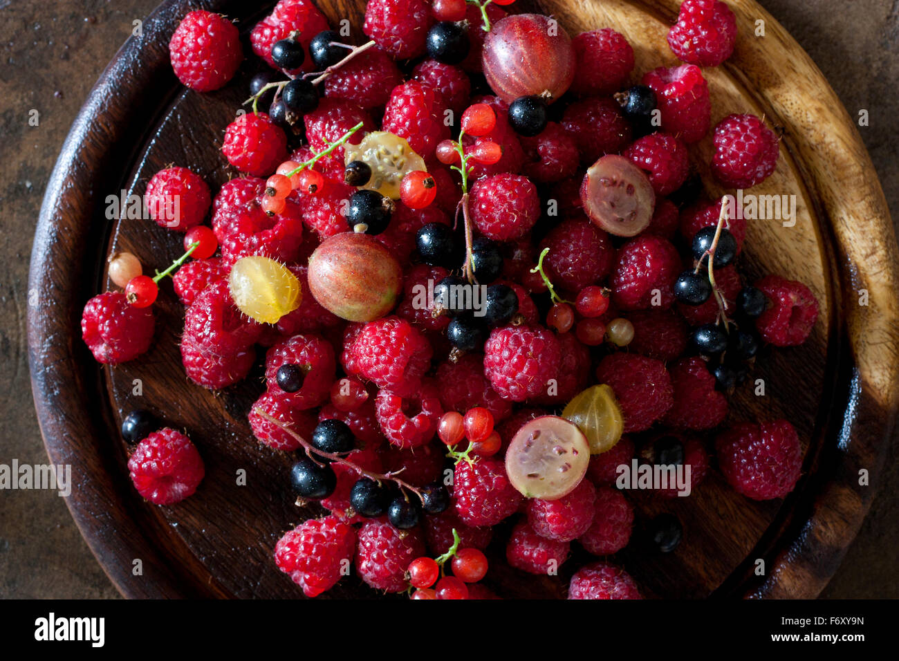 Mixed Berries on board - Stock Image