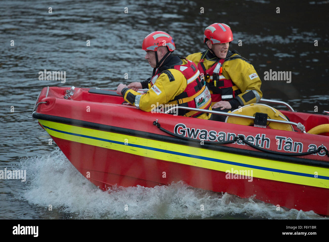 A South Wales Fire and Rescue team use a speed boat to search for a person seen entering the River Taff in Cardiff, - Stock Image