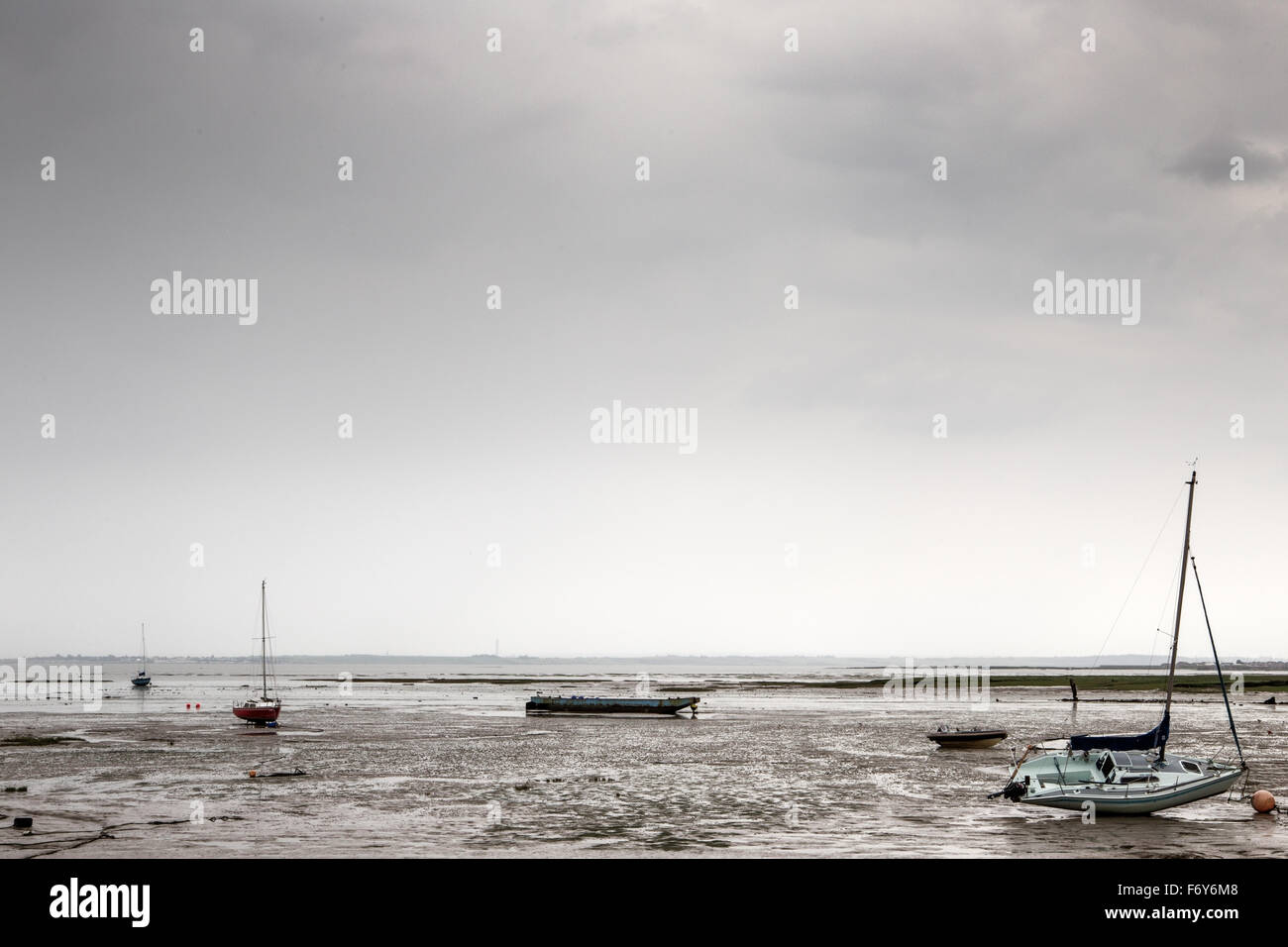 landscape image looking at across the muddy beach of the essex coastline of westcliff on sea in england Stock Photo