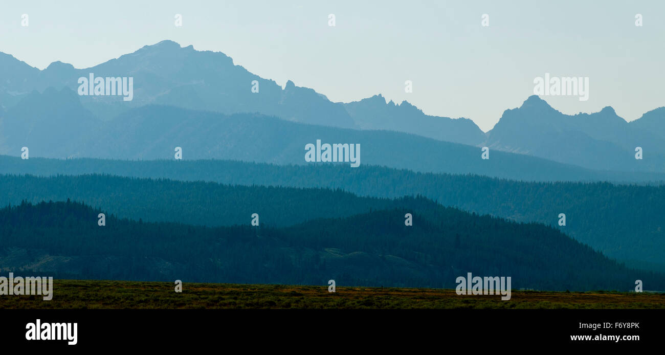 Sawtooth Mountains in haze from nearby forest fires. - Stock Image