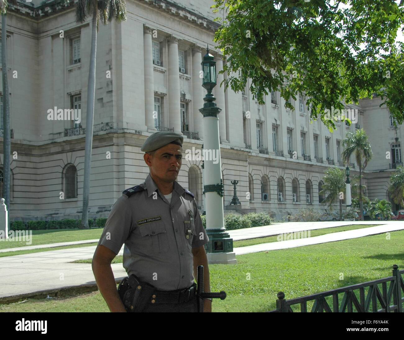 A member of the special police at the capital building in Havana, Cuba - Stock Image