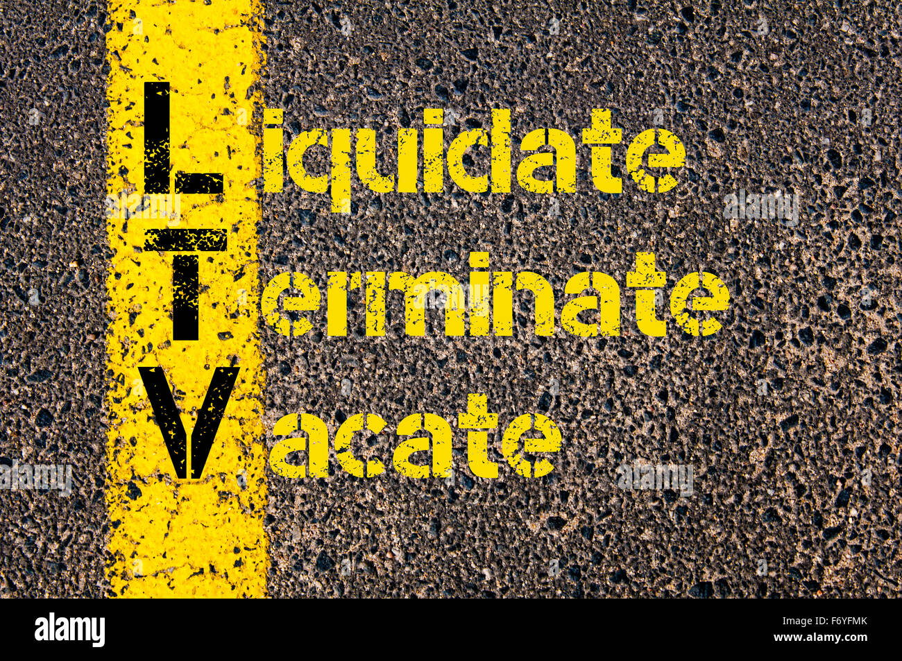 Concept image of Business Acronym LTV as Liquidate, Terminate, Vacate written over road marking yellow paint line. - Stock Image