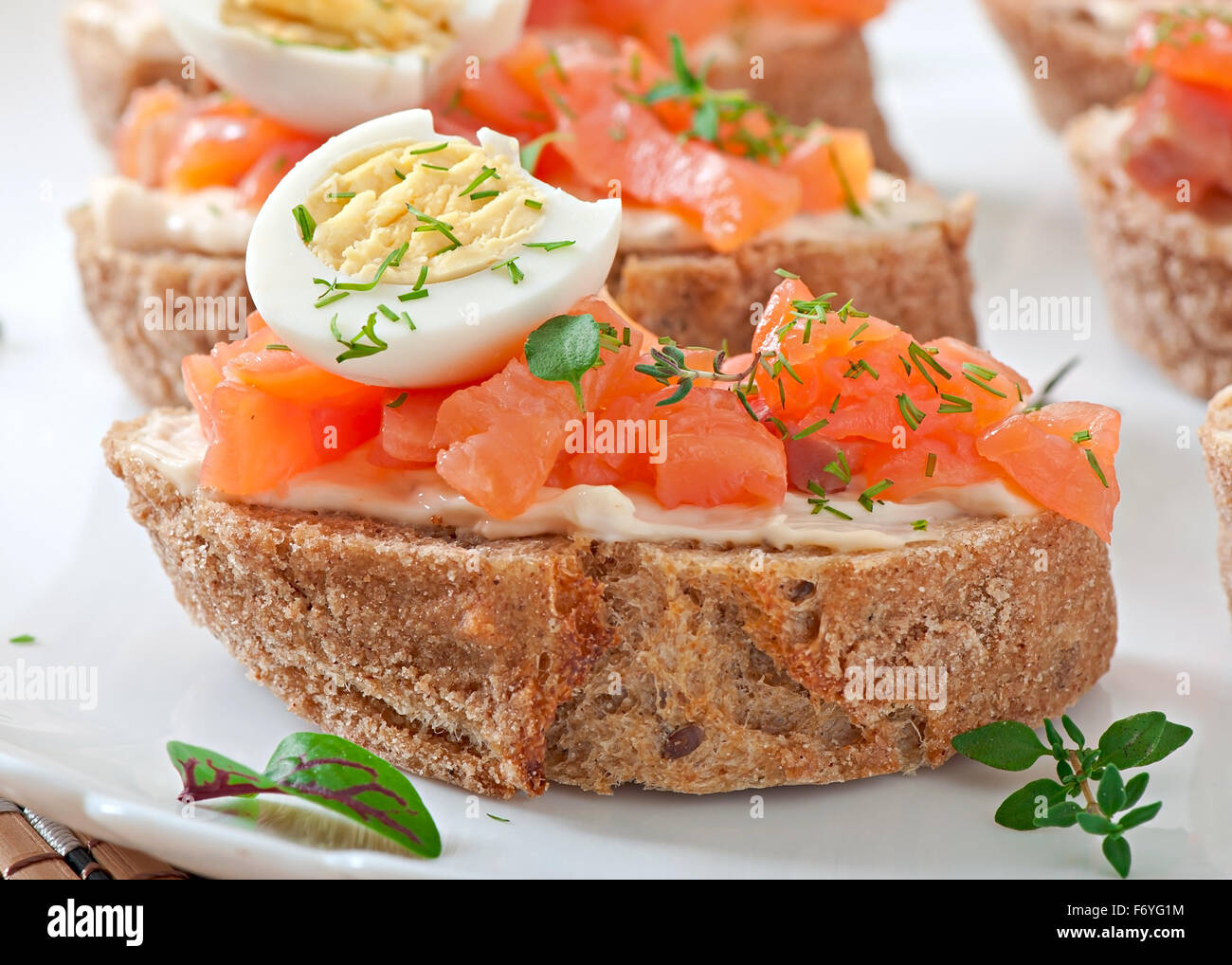 Sandwich with salted salmon and cream cheese. - Stock Image