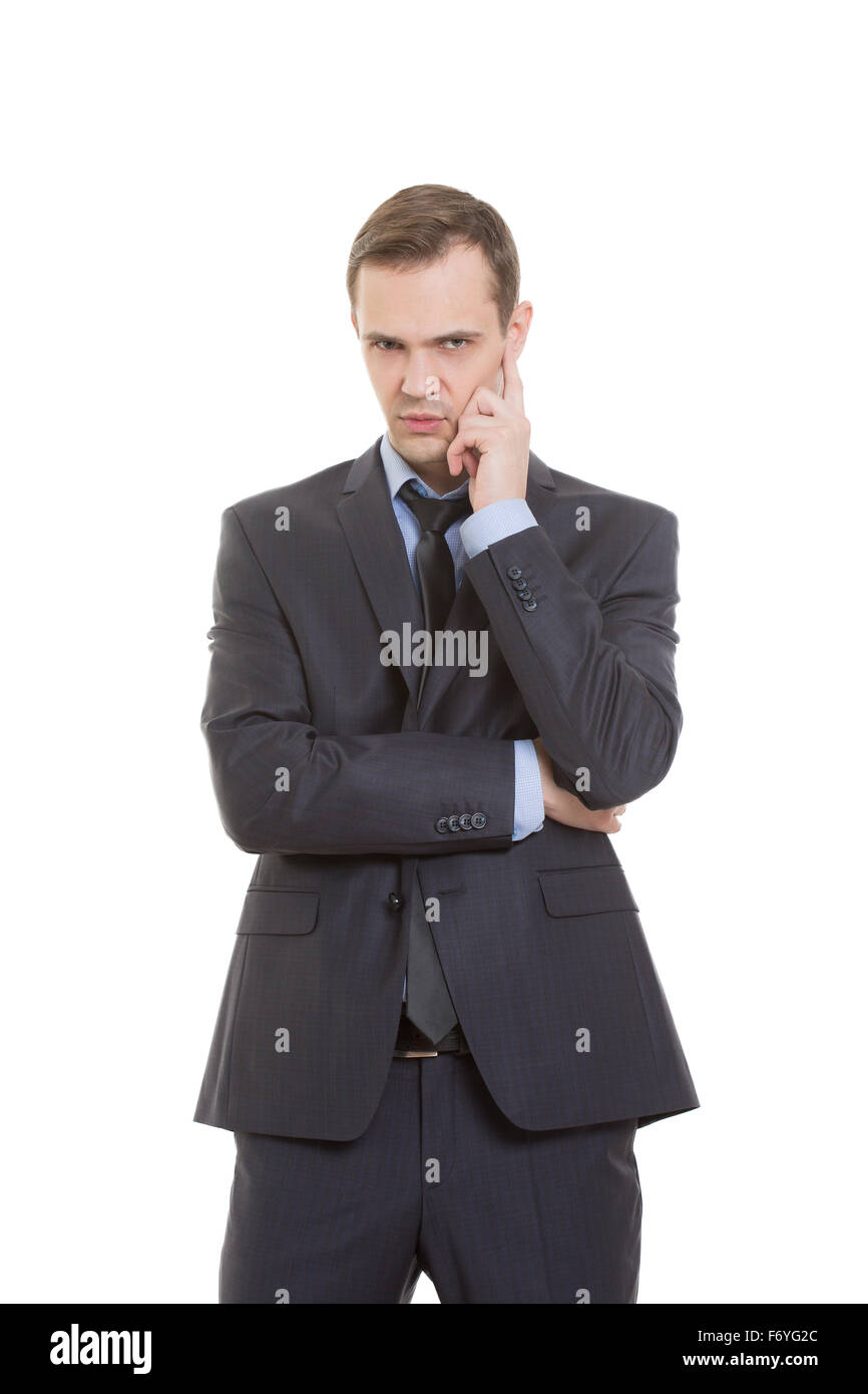 gestures distrust lies. body language. man in business suit isolated on white background. pulls the earlobe - Stock Image