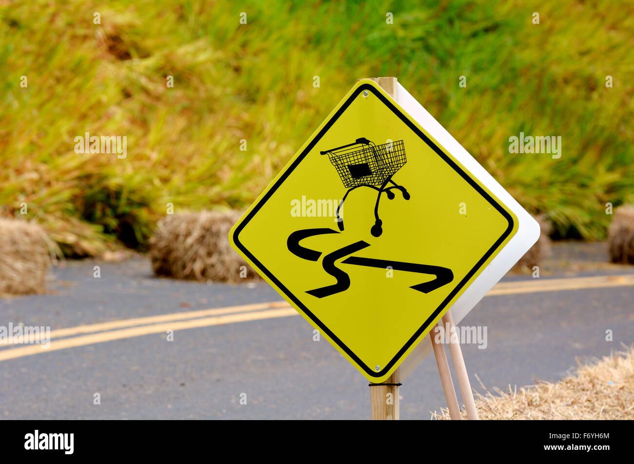 Dangerous slippery road sign of shopping trolley on the roadside.Conceptual concept and ideas background with copy - Stock Image