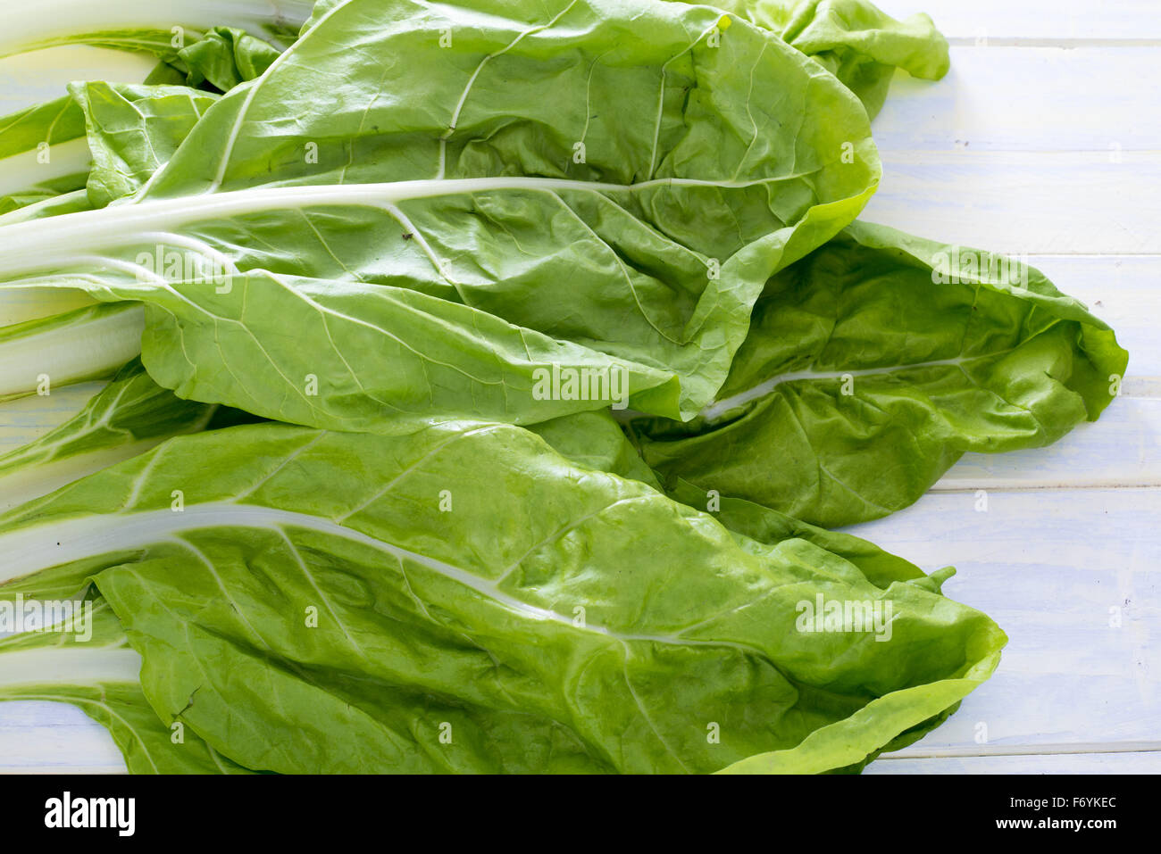 Swiss Chard Leaves On White Painted Wood Stock Photo Alamy