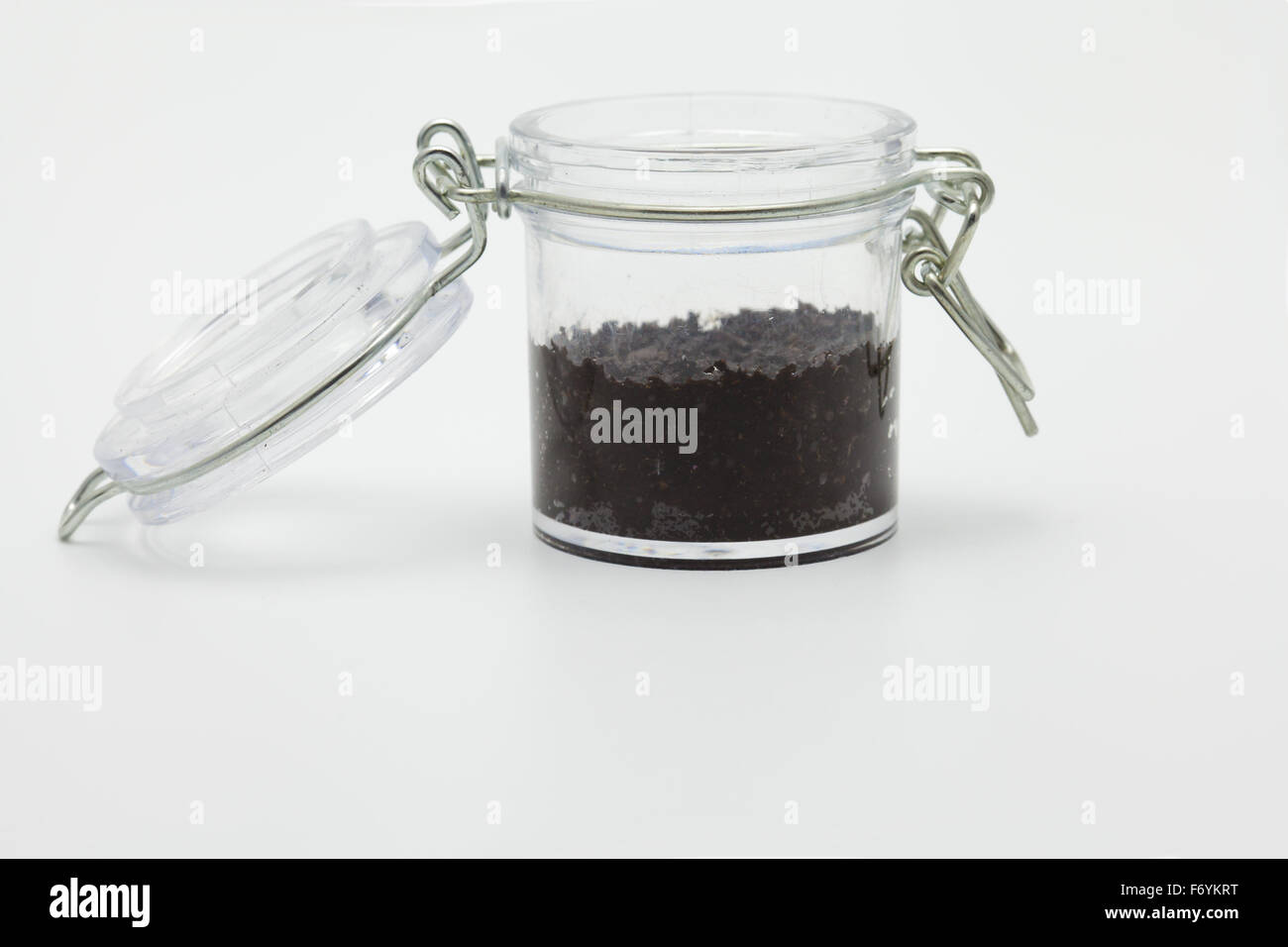 ecology concept little glass jar with soil stock photo 90348044