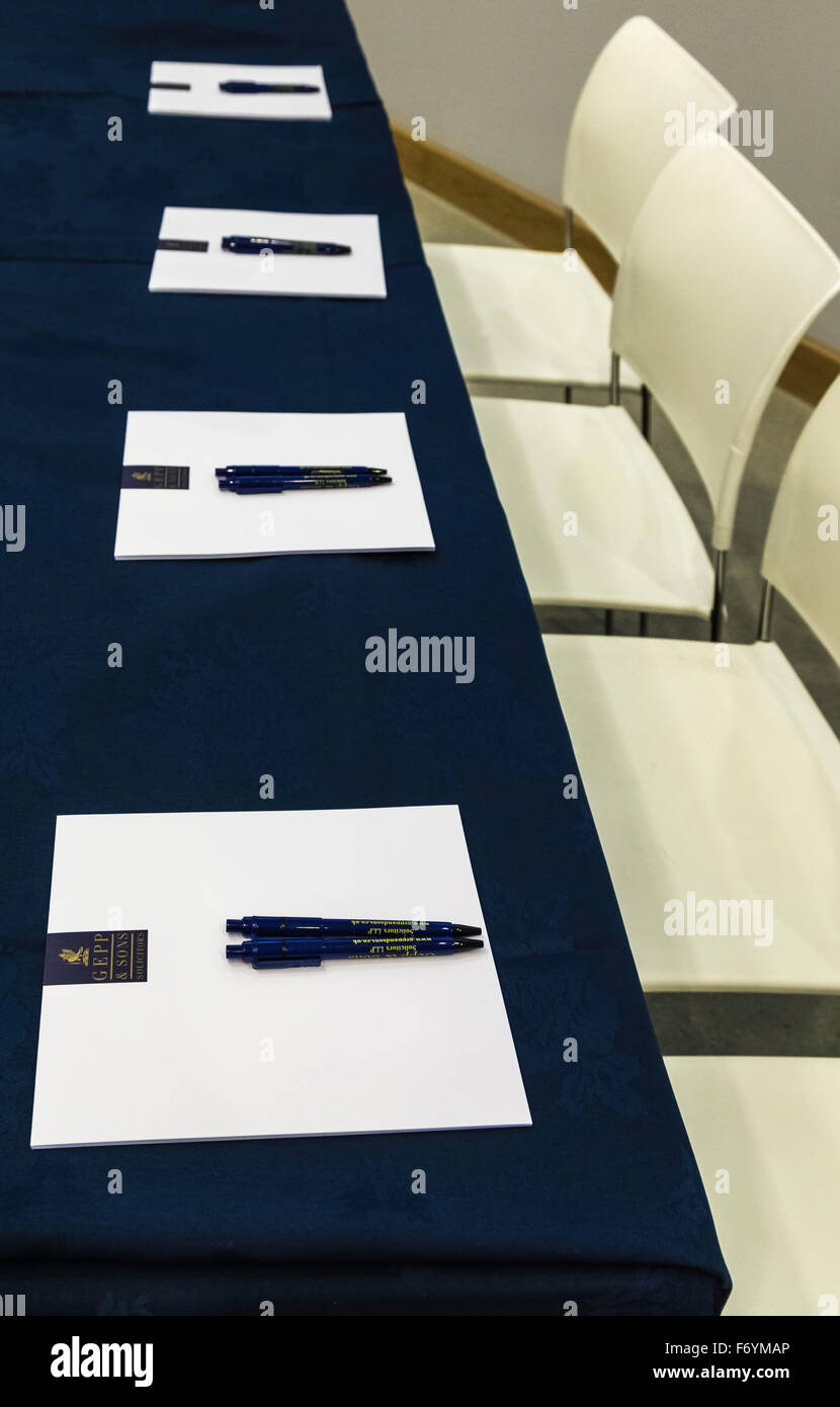 Table and 4 chairs with Note Pads and Pens - Stock Image
