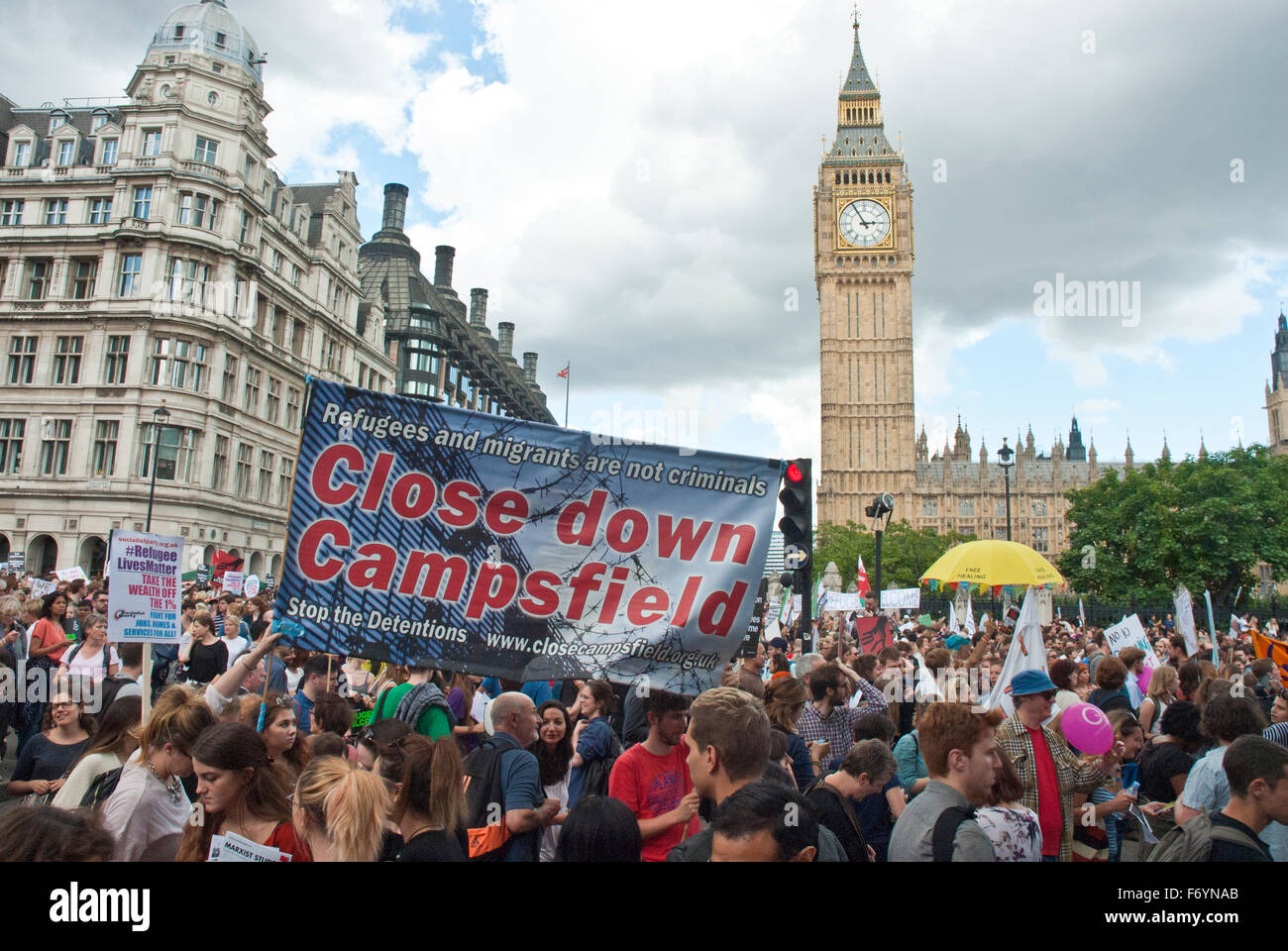 'Refugees welcome here' demonstration. Posters include 'Close Down Campsfield' (detention centre). - Stock Image