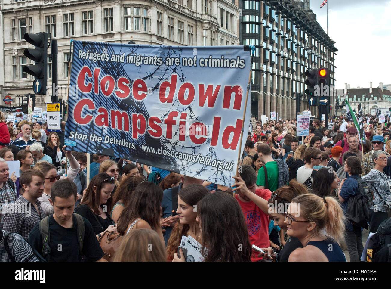 'Refugees welcome here' demonstration. Posters include 'Close Down Campsfield' detention centre. - Stock Image