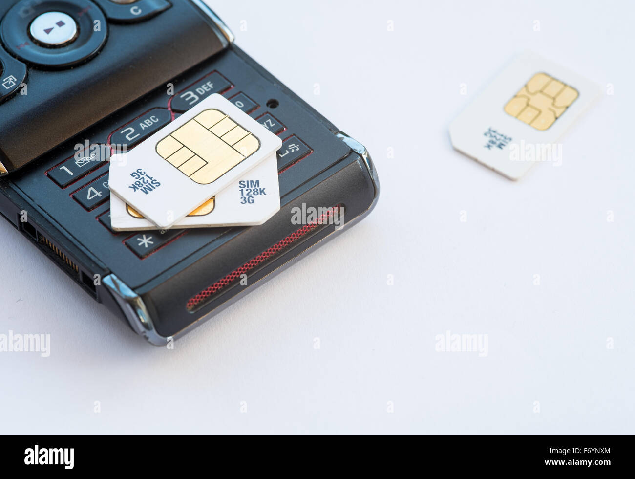 Group of mobile subscriber Identity Module, 3g memory sim cards  on a used black mobile - Stock Image