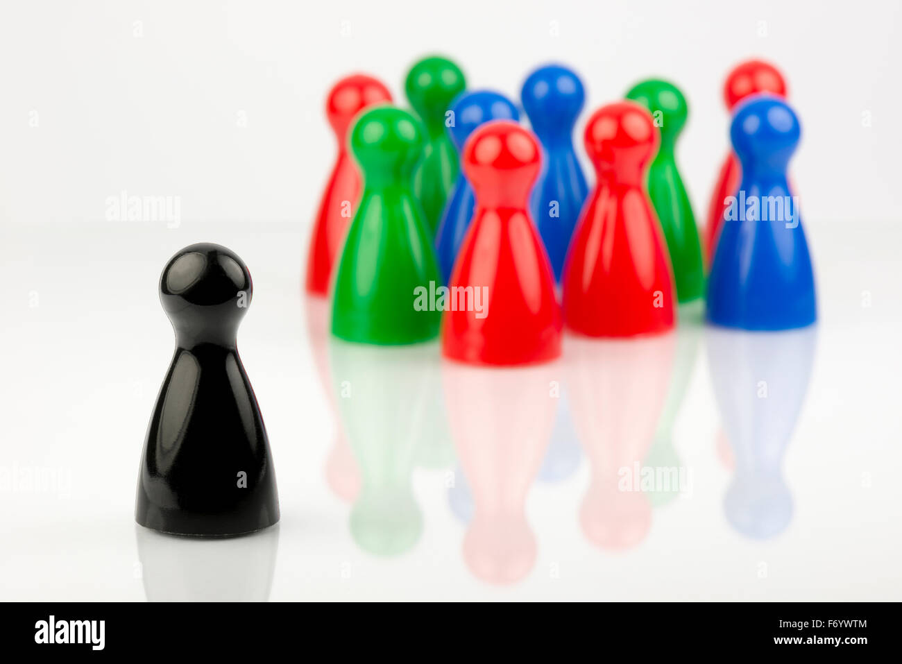 Conceptual game pawns that depict the concept different - Stock Image