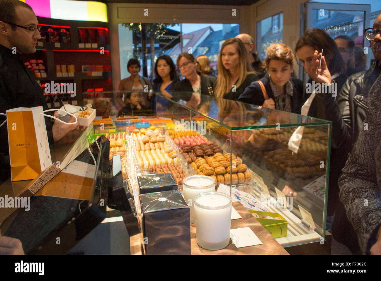 Paris, France, Women Shopping in Chocolate Shop 'Pierre Hermé' Chocolatier, Pastries in Mall, Centre - Stock Image