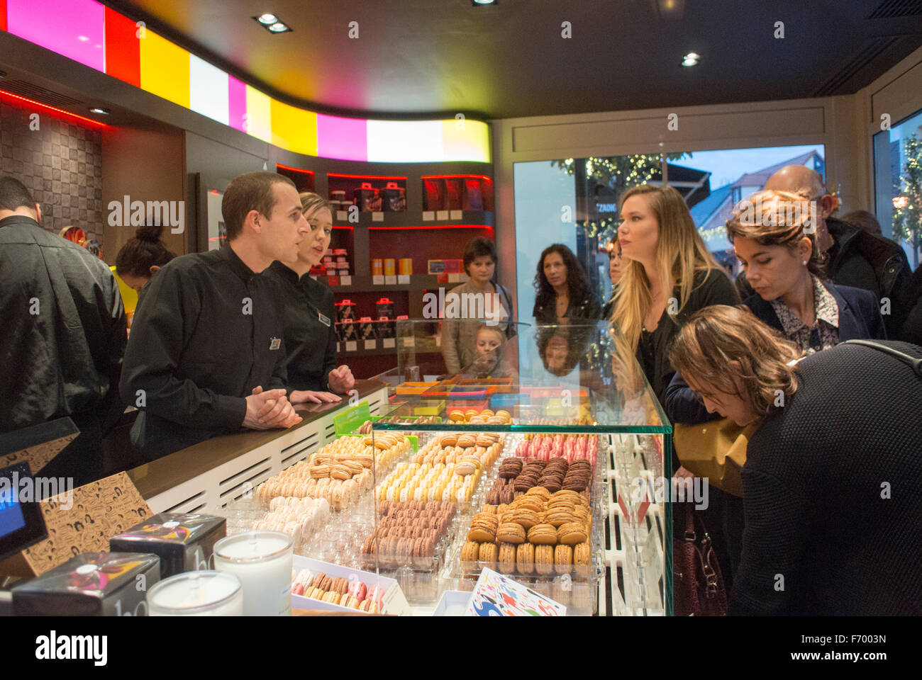Paris, France, Women Buying, Shopping in Chocolate Shop 'Pierre Hermé' Chocolatier in Pastries, Mall, - Stock Image