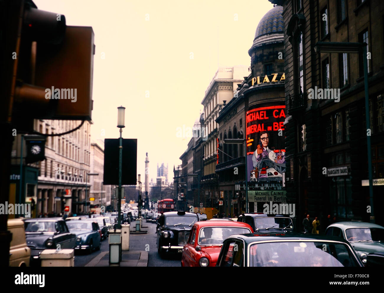 Vintage image of London, UK taken in April 1967 with a billboard showing a Michael Caine show - Stock Image