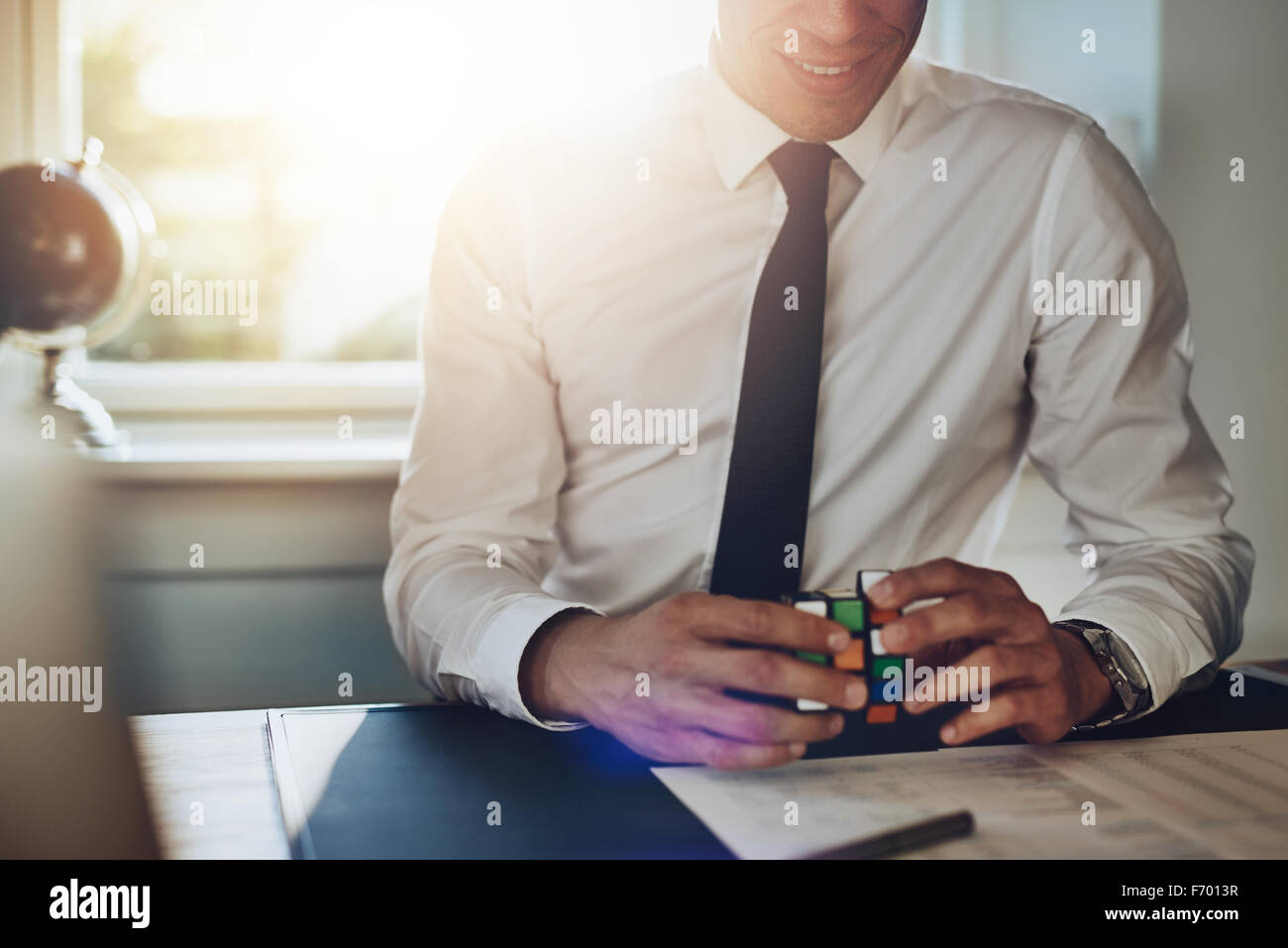 Business man getting ideas at his desk and solving problems - Stock Image