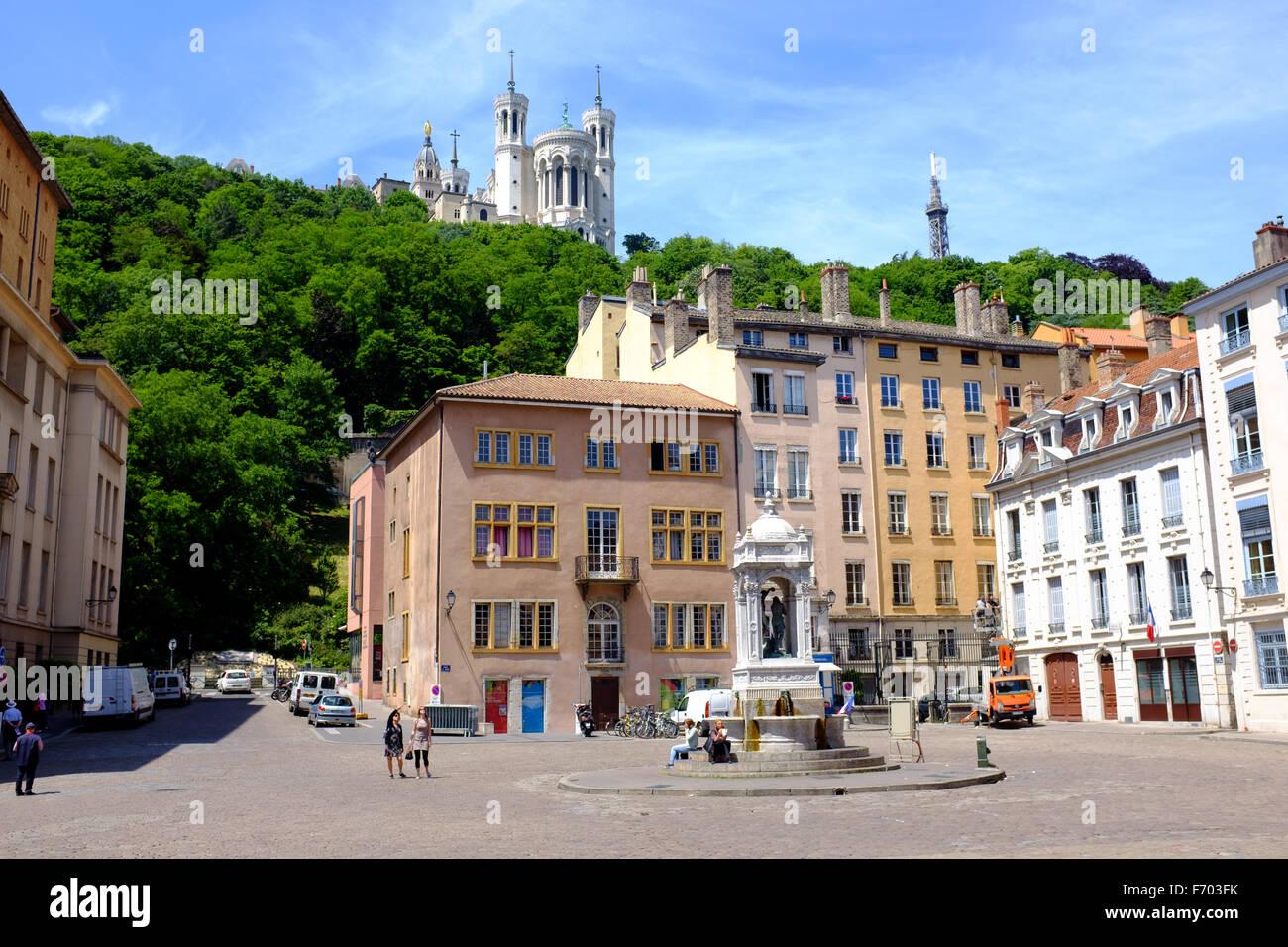 Place Saint Jean with Basilique Notre Dame de Fourviere above in Vieux Lyon, France - Stock Image