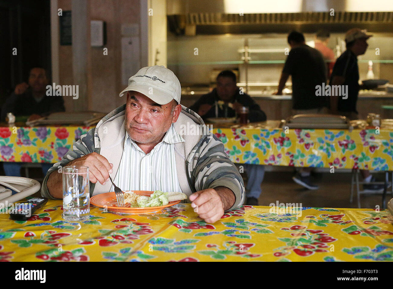 St Helena, CA, USA. 19th Nov, 2015. Jesus Teña watches television while he eats dinner at the River Ranch - Stock Image