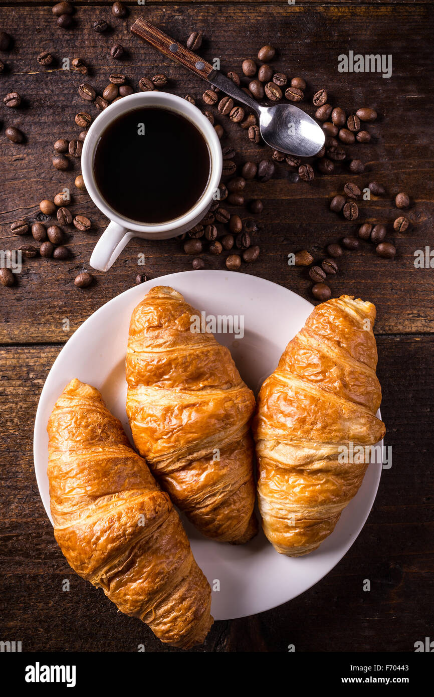 Top View Of Coffee And Croissant With Coffee Bean Stock