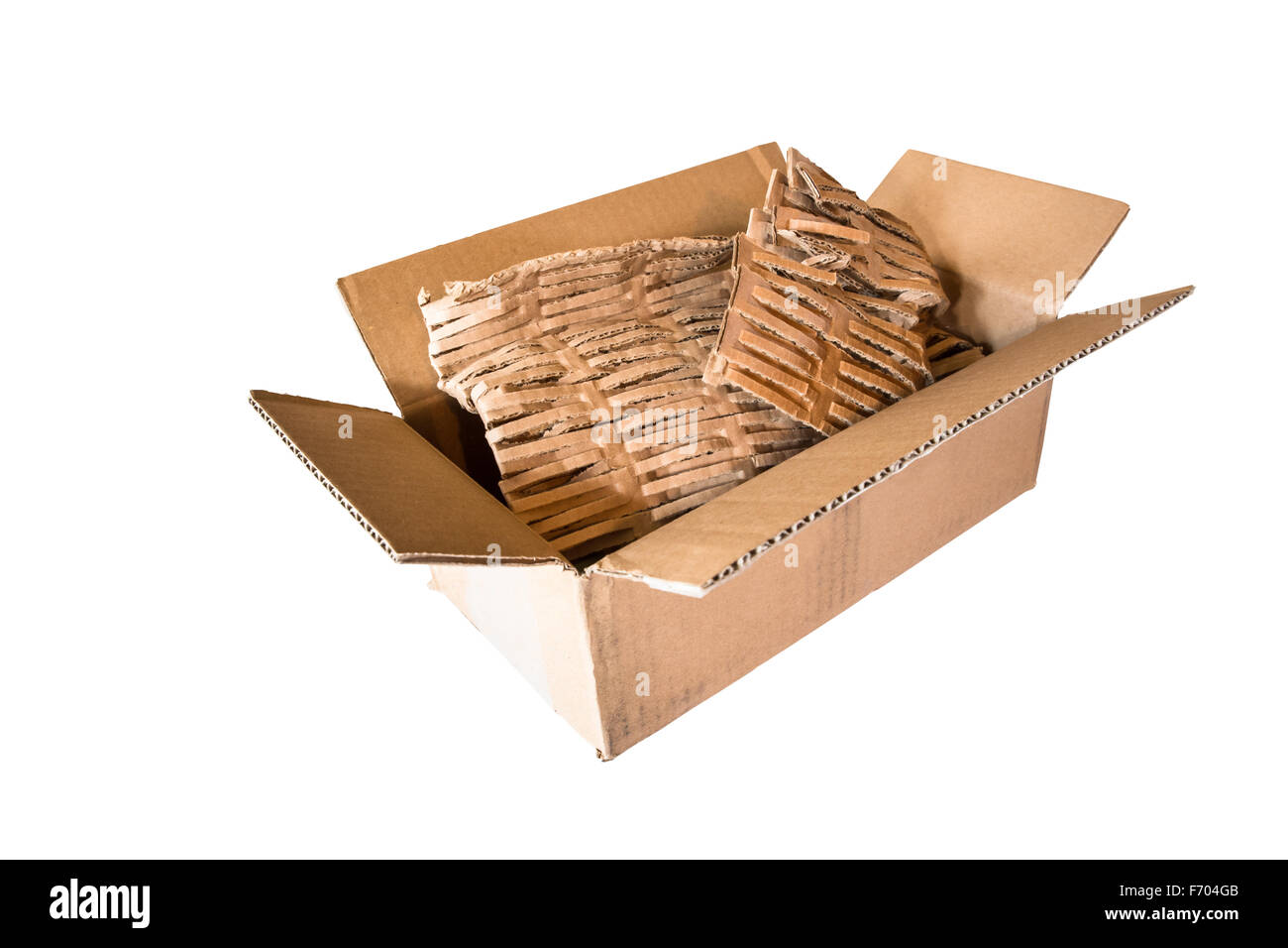 Open empty cardboard shipping box with eco-friendly packing material on isolated white background - Stock Image