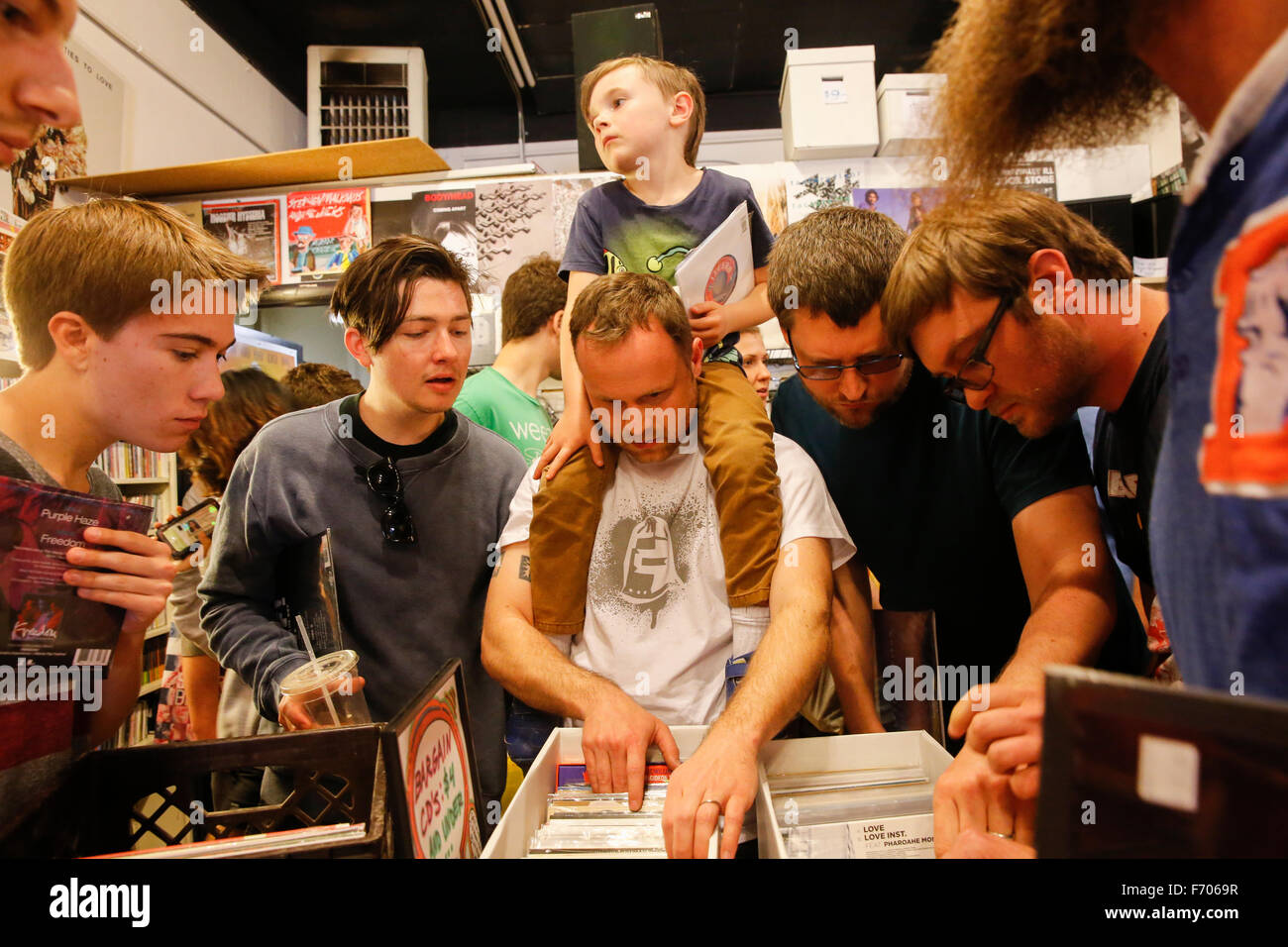 Vinyl record shoppers for Record Store Day 2015 pack locally owned record store Landlocked Records. (Photo by Jeremy - Stock Image