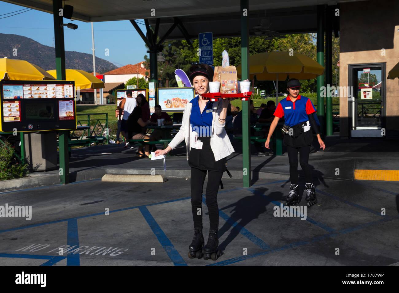 Southern California, USA, April 12, 2015, Car Hop, Waitress on rollerskates - Stock Image