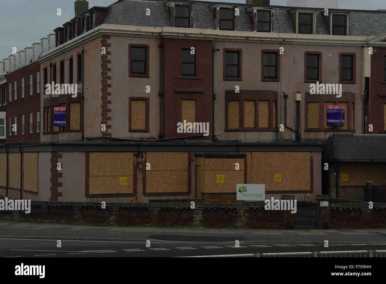 The closed-down and boarded-up windows of the former Abbeydale Care Home, Harrow Place at New South Promenade, Blackpool, - Stock Image