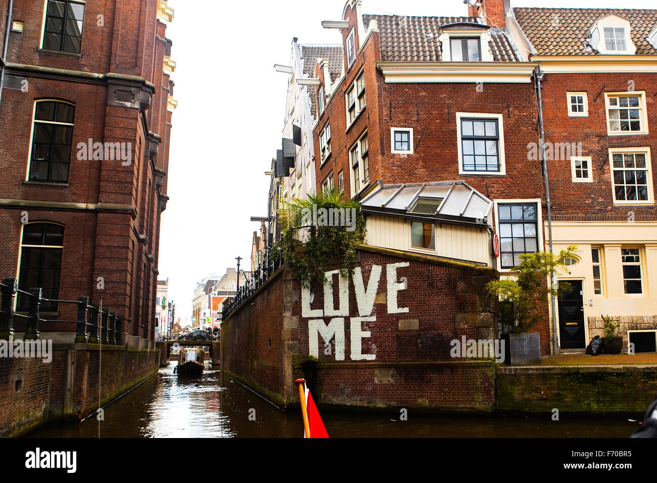 Wall Of A Canal Side House In Amsterdam That Has U0027Love Meu0027 Painted On It In  Large White Letters