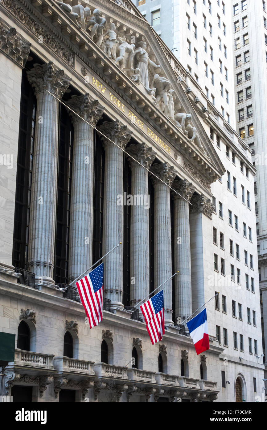 French flag flying on the New York Stock Exchange next to the Stars and Strips - Stock Image