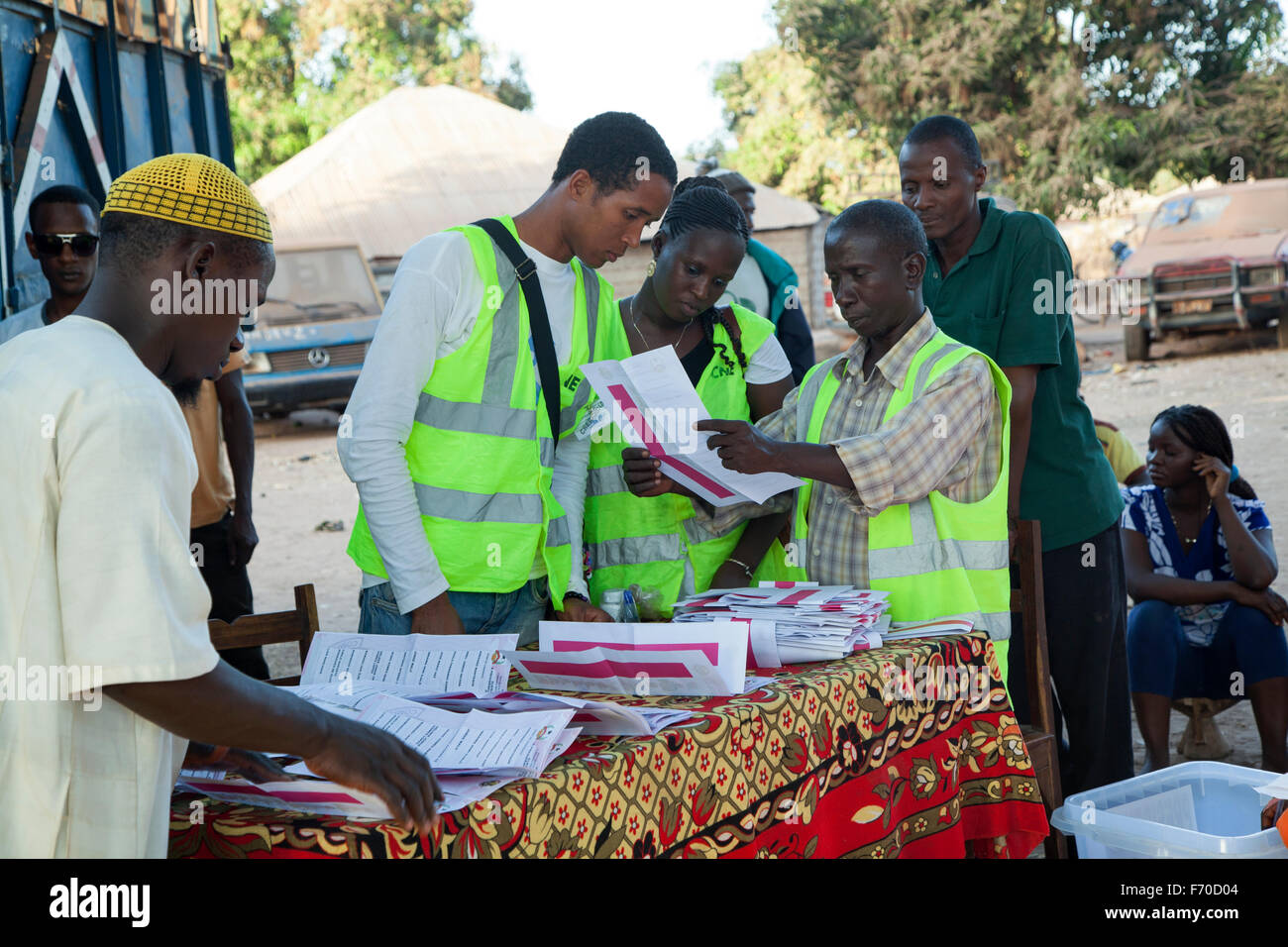 Polling station, ballot boxes and international election observer in rural Guinea-Bissau during general elections - Stock Image