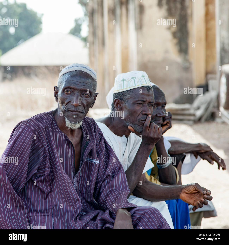 Gabu, Guinea-Bissau - May 7, 2014: Portrait of African village elders. Everyday scenes in rural Guinea-Bissau. - Stock Image