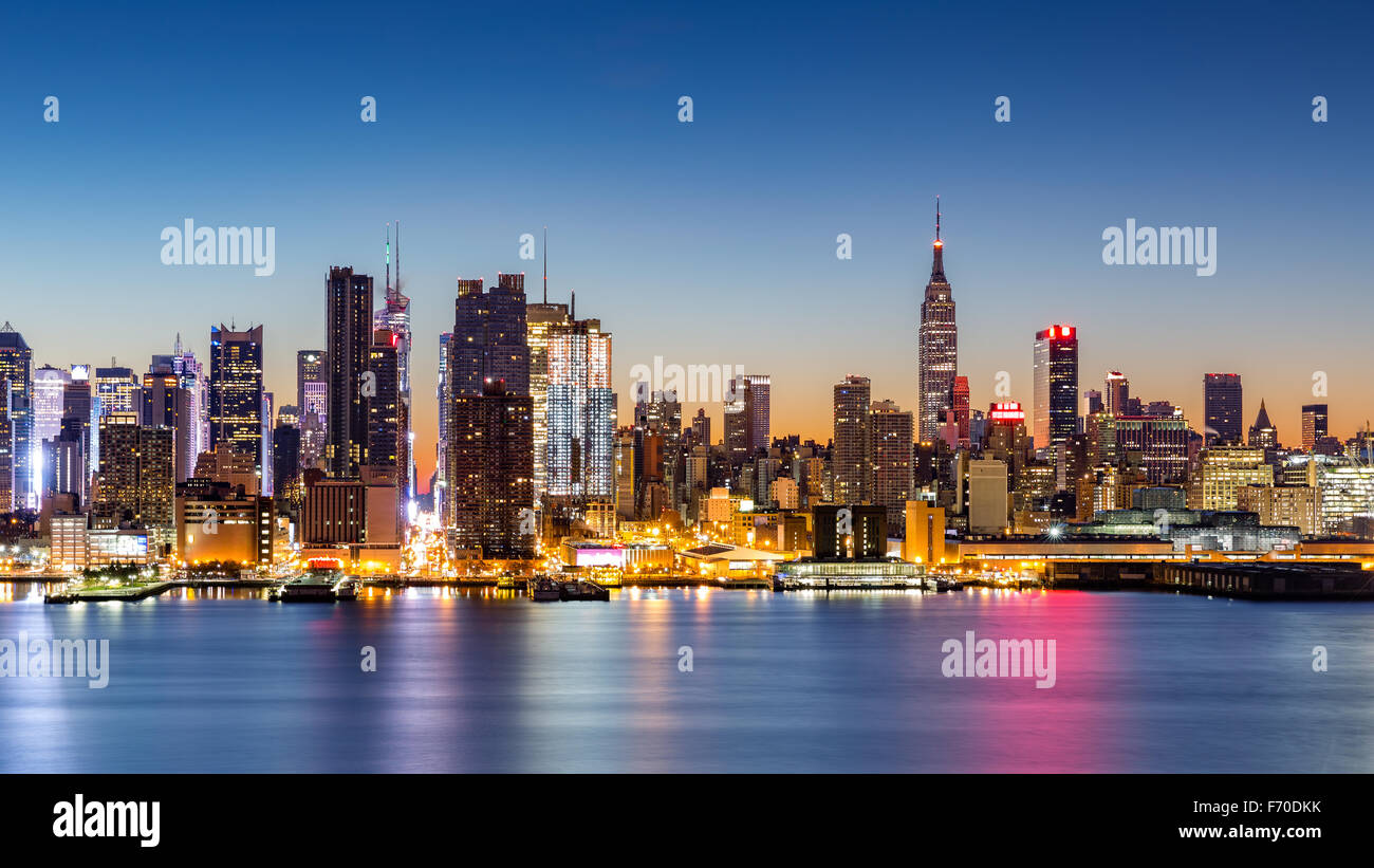 New York City skyline at dawn, as viewed from Weehawken, along the 42nd street canyon Stock Photo