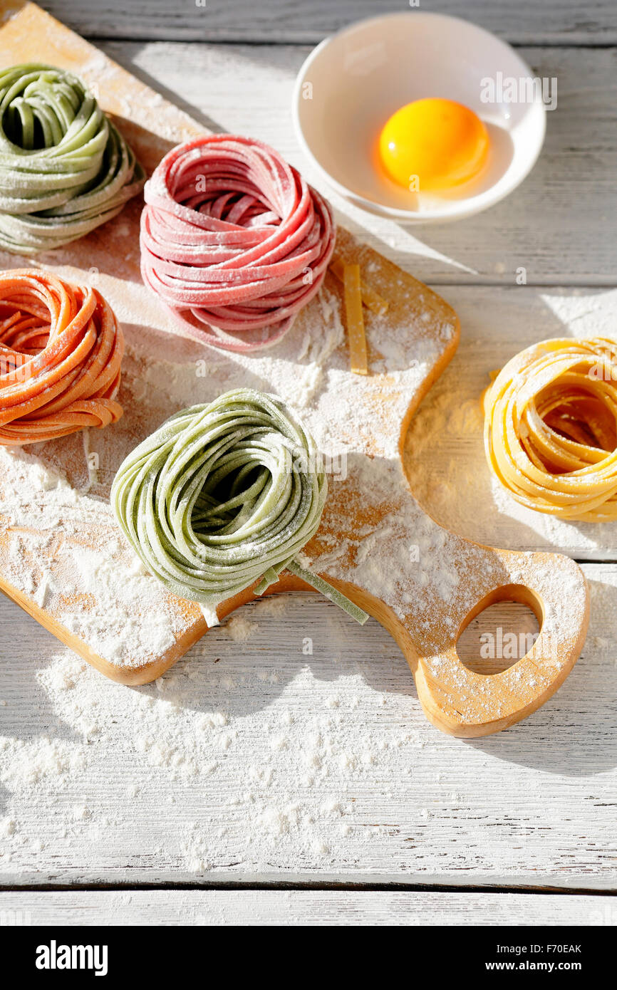 raw homemade color pasta, top - Stock Image