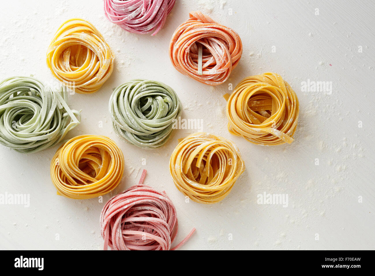 raw pasta on white background, food top view - Stock Image