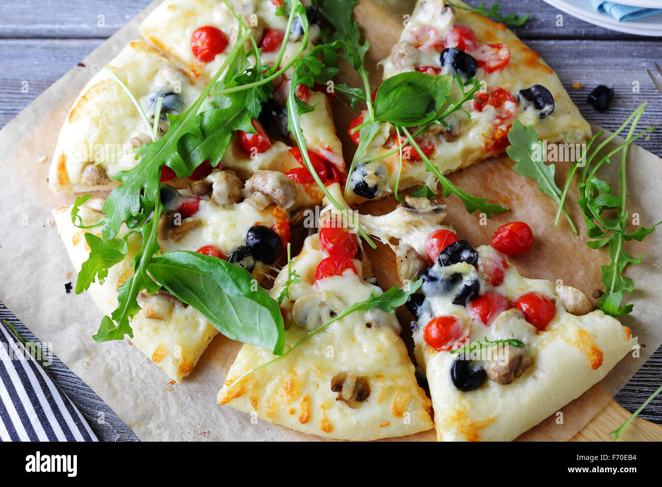 hot pizza with mushrooms and herbs - Stock Image