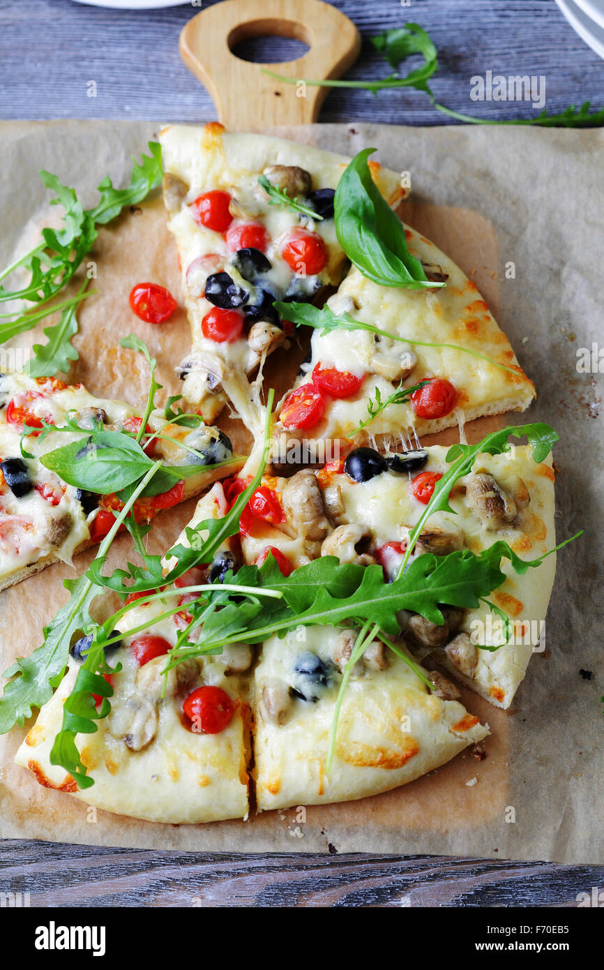 cheese pizza with mushrooms and cherry tomatoes, top - Stock Image