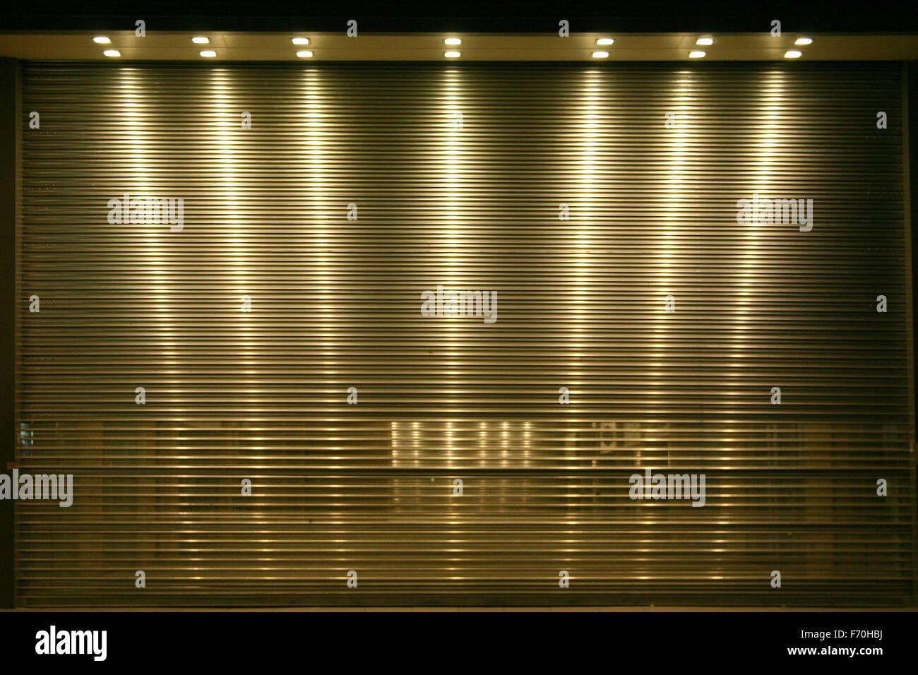 Down lit roller door - Stock Image