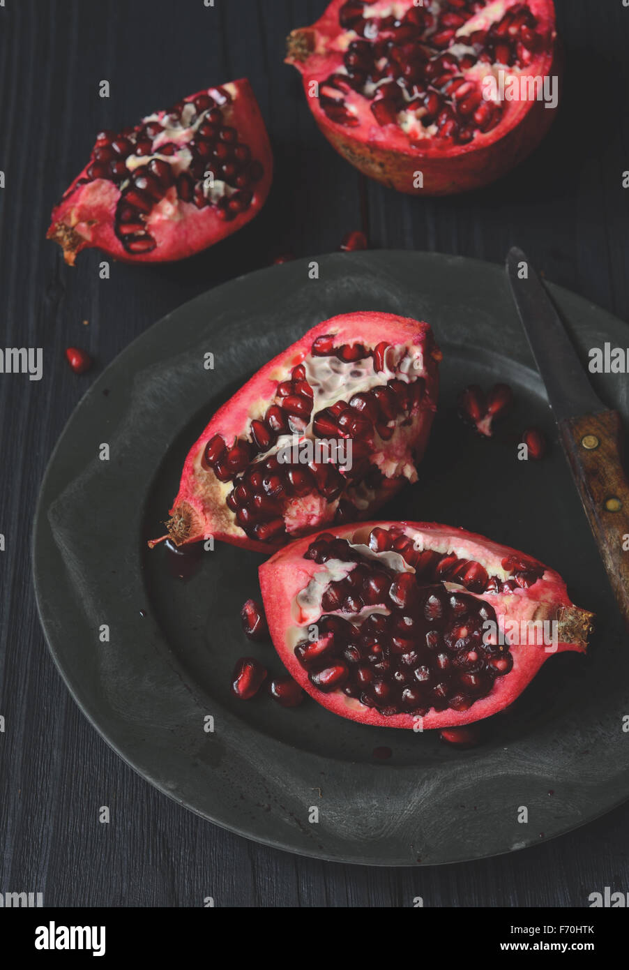 Pieces and grains of ripe pomegranate fruit - Stock Image