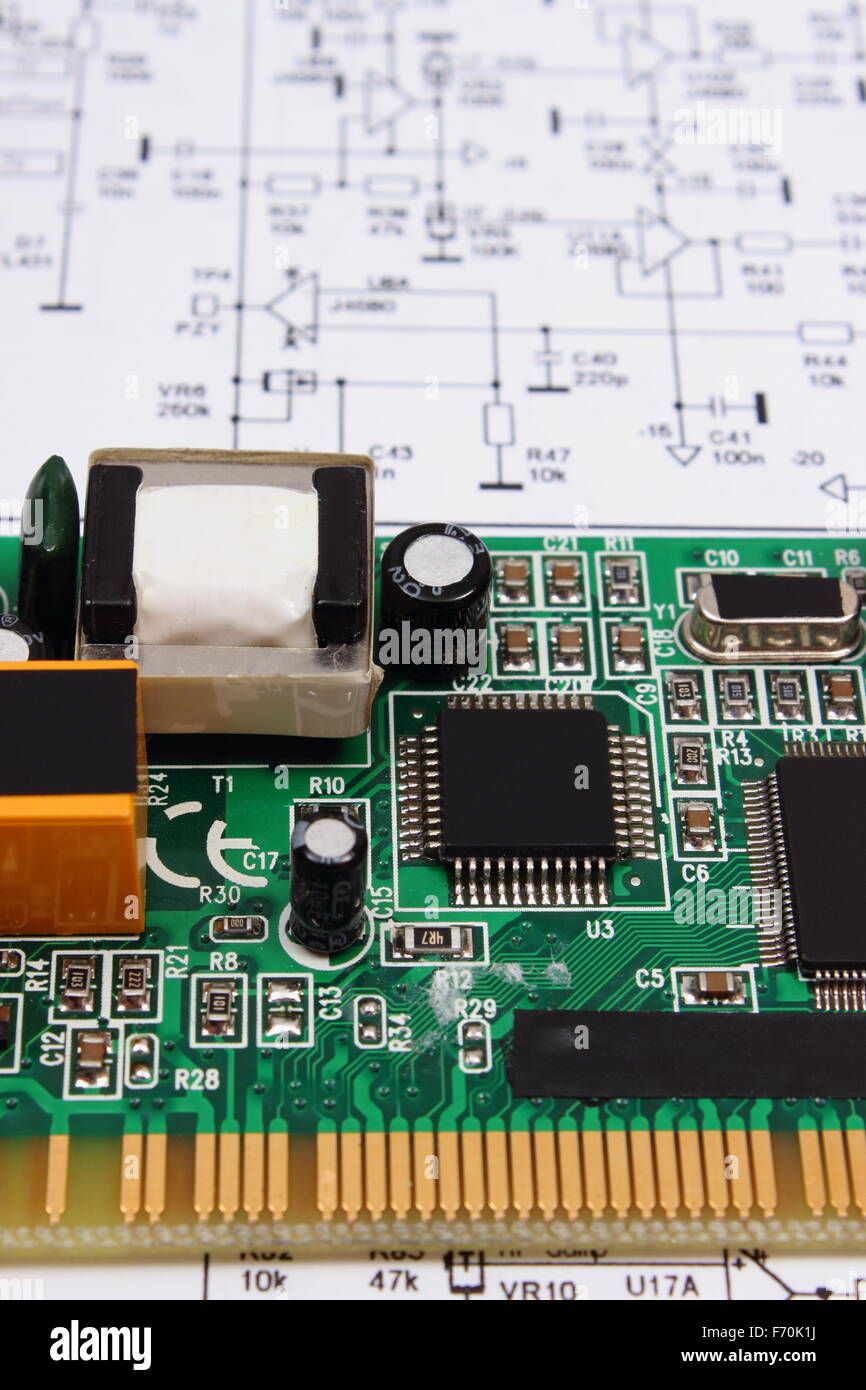 printed circuit board with electrical components lying on stock